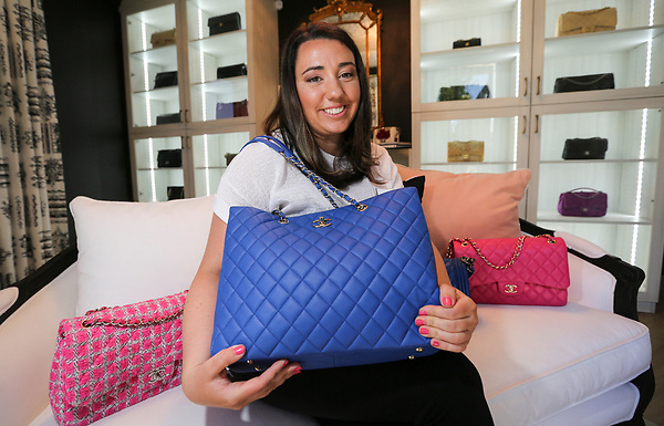 April 20, 2017. Carlsbad, CA. USA. Christina Samoylov owner of Designer Vault in Carlsbad holds a  Chanel purse.  Photos by Jamie Scott Lytle. Copyright.