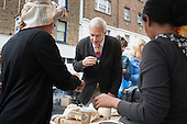 Jon Snow at a coffee stall, Camden Council launch of revamped Chalton Street market.