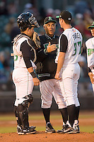 Dayton Dragons pitching coach Tony Fossas #36 chats with starting pitcher Matt Fairel #32 and catcher Jordan Wideman #23 at Fifth Third Field April 21, 2009 in Dayton, Ohio. (Photo by Brian Westerholt / Four Seam Images)