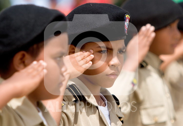 """Venezuelan military school boys march during a military parade in Valencia, Venezuela, on Saturday, June 24, 2006. The military parade was to celebrate Army Day and took place in """"Campo de Carabobo"""", the field where the last big battle for the Venezuelan independence was won. (ALTERPHOTOS/Alvaro Hernandez)."""