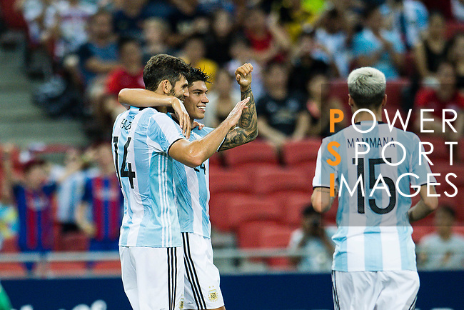 Carlos Correa of Argentina (R) celebrating a score with Federico Fazio of Argentina (L) during the International Test match between Argentina and Singapore at National Stadium on June 13, 2017 in Singapore. Photo by Marcio Rodrigo Machado / Power Sport Images