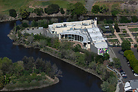 aerial photograph of the former Copia museum, The American Center for Wine, <br /> Food and the Arts,  which houses the Culinary Institute of America, Napa County, California.  It is located in downtown Napa along the Napa River.