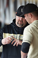 Wake Forest Demon Deacons assistant coach John Hendricks (left) goes over a pitch grip with starting pitcher Jared Shuster (41) during the game against the Notre Dame Fighting Irish at David F. Couch Ballpark on March 10, 2019 in  Winston-Salem, North Carolina. The Demon Deacons defeated the Fighting Irish 7-4 in game one of a double-header.  (Brian Westerholt/Four Seam Images)