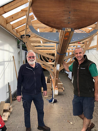 Howth 17 measurer Rupert Jeffares with new owner-builder Gerry Comerford and Anna