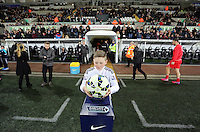 SWANSEA, WALES - MARCH 16: A boy mascot rests the ball on the Barclays pedestal prior to the Premier League match between Swansea City and Liverpool at the Liberty Stadium on March 16, 2015 in Swansea, Wales