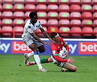 10th October 2020; Bescot Stadium, Walsall, West Midlands, England; English Football League Two, Walsall FC versus Colchester United; Rory Holden of Walsall is brought down and fouled by Miquel Scarlett of Colchester United