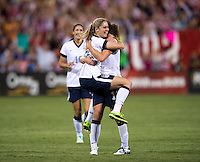 Morgan Brian (25) of the USWNT celebrates her first career goal with teammate Lauren Holiday (12) during an international friendly at RFK Stadium in Washington, DC.  The USWNT defeated Mexico, 7-0.