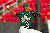 Relief pitcher Natividad Dilone #38 of the Greensboro Grasshoppers in action against the Hickory Crawdads at  L.P. Frans Stadium July 10, 2010, in Hickory, North Carolina.  Photo by Brian Westerholt / Four Seam Images