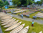 Masses of handmade boats are lined up at a traditional market which has showcased vessels for half a century.  The builders trudge through a grassy field filled with monsoon water to sell their creations.<br /> <br /> Demand has increased for the small boots as inhabitants of the Manikganj district in Dhaka, Bangladesh, use them to travel in the flood-prone area during monsoon season. SEE OUR COPY FOR DETAILS.<br /> <br /> Please byline: Mustasinur Rahman Alvi/Solent News<br /> <br /> © Mustasinur Rahman Alvi/Solent News & Photo Agency<br /> UK +44 (0) 2380 458800