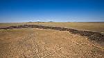 4 Extinct Volcanos and Petroglyphs on the messa west of Albuquerque New Mexico helicopter aerial