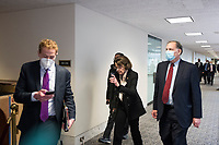 United States Senator Dianne Feinstein (Democrat of California) and other Senators evacuate to a safe place in the Dirksen Senate Office Building after Electoral votes being counted during a joint session of the United States Congress to certify the results of the 2020 presidential election in the US House of Representatives Chamber in the US Capitol in Washington, DC on Wednesday, January 6, 2021, as interrupted as thousands of pr-Trump protestors stormed the U.S. Capitol and the House chambers.  .<br /> Credit: Rod Lamkey / CNP/AdMedia