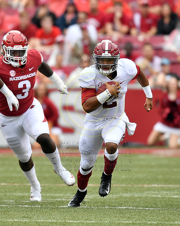 Alabama quarterback JALEN HURTS runs for a first down during Saturday's game against Arkansas at Donald W. Reynold Razorback Stadium in Fayetteville.