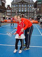 The Netherlands, Den Bosch, 16.04.2014. Fed Cup Netherlands-Japan, Street tennis on the market in the city center, with Fed Cup Team, Kiki Bertens shows how it's done<br /> Photo:Tennisimages/Henk Koster