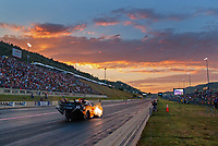 Jul 19, 2019; Morrison, CO, USA; NHRA funny car driver J.R. Todd races at sunset during qualifying for the Mile High Nationals at Bandimere Speedway. Mandatory Credit: Mark J. Rebilas-USA TODAY Sports