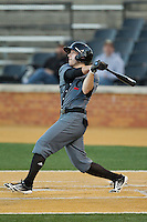 Matt Williams (22) of the Cincinnati Bearcats follows through on his swing against the Wake Forest Demon Deacons at Wake Forest Baseball Park on February 21, 2014 in Winston-Salem, North Carolina.  The Bearcats defeated the Demon Deacons 5-0.  (Brian Westerholt/Four Seam Images)