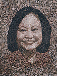 Pictured: Justin's portrait of Kim Phuc Phan Thi, who is famously known as the 'Napalm Girl'. <br /> <br /> A British artist stuck in Thailand has spent his time constructing masterpieces from pebbles for locals to enjoy.  Justin Bateman had only planned on staying in Chiang Mai for a week - but has remained there now for nearly ten months after the pandemic struck. <br /> <br /> His pebble portraits include The Queen, Spanish painter Pablo Picasso, Michelangelo's David and a local farmer - who was bemused by his portrait.   Mr Bateman, from Portsmouth, Hants, was staying in Bali when he travelled to Chiang Mai, in Thailand, to visit some friends.   SEE OUR COPY FOR DETAILS.<br /> <br /> Please byline: Justin Bateman/Solent News<br /> <br /> © Justin Bateman/Solent News & Photo Agency<br /> UK +44 (0) 2380 458800
