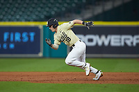Pat DeMarco (18) of the Vanderbilt Commodores hustles towards second base against the Houston Cougars during game nine of the 2018 Shriners Hospitals for Children College Classic at Minute Maid Park on March 3, 2018 in Houston, Texas. The Commodores defeated the Cougars 9-4. (Brian Westerholt/Four Seam Images)