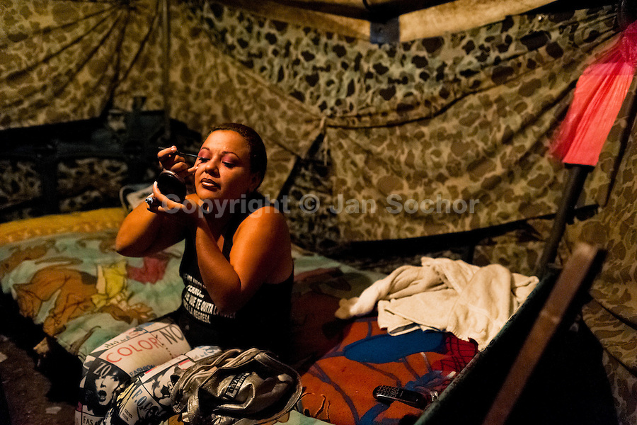 A Salvadorean woman applies makeup before her dancing performance at the Circo Brasilia, a family run circus travelling in Central America, 10 May 2011. The Circo Brasilia circus belongs to the old-fashioned traveling circuses with a usual mixture of acrobat, clown and comic acts. Due to the general loss of popularity caused by modern forms of entertainment such as movies, TV shows or internet, these small family enterprises balance on the edge of survival. Circuses were pushed away and now they have to set up their shows in more remote villages. The circus art and culture is slowly dying in Latin America.
