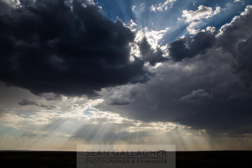Monsoon storm clouds gather over drought-hit farmland near Latur, Maharashtra, western India.
