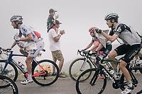 newspapers for insulation during the upcoming descent of the Port de Balès (HC/1755m/11.7km/7.7%)<br /> <br /> 104th Tour de France 2017<br /> Stage 12 - Pau › Peyragudes (214km)