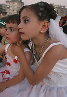 Palestinian girls are dressed up during a mass wedding party for grooms organized by the Islamic Association in the town of Jabalia northern Gaza Strip, Thursday, Aug. 16. 2007. The gathering marked the marriage for more than 50 men from the Islamic group Hamas.(photo by Fady Adwan""