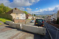 """Pictured: Concrete barriers have been installed on Waun-Wen Road, in the area where cars were set ablaze and vandalised in the Mayhill area of Swansea, Wales, UK. Saturday 22 May 2021<br /> Re: Gangs of """"yobs"""" have set fire to cars and rolled them down a hill in Swansea, Wales, UK.<br /> South Wales Police said they attended """"large scale disorder"""" in the Mayhill area of the city on Thursday evening."""