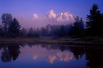 Sunrise and fog along the Snake River with the reflection of Grand Teton Peak behind, Grand Teton National Park, Jackson Hole, Wyoming, USA .  John leads private photo tours throughout Colorado. Year-round Colorado photo tours. John offers private photo tours in Grand Teton National Park and throughout Wyoming and Colorado. Year-round.