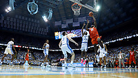 CHAPEL HILL, NC - JANUARY 11: Aamir Simms #25 of Clemson University shoots a layup over Leaky Black #1 and Andrew Platek #3 of the University of North Carolina during a game between Clemson and North Carolina at Dean E. Smith Center on January 11, 2020 in Chapel Hill, North Carolina.