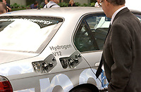 June 10 2002, Montreal, Quebec, Canada; <br /> <br /> Pedestrians take a moment to look at a<br />  BMW liquid hydrogen-fueled vehicle, series 750 HL<br /> displayed near the Fairmount-Queen Elizabeth Hotel in Montreal, Canada<br /> where the 14th World Hydrogen Energy Conference is beeing held, June 10 to 12, 2002<br /> <br /> <br /> NOTE :  D-1 H original JPEG, saved as Adobe 1998 RGB