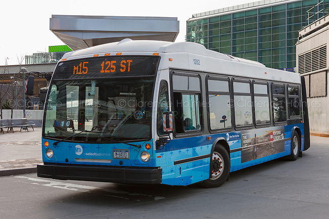 An M15 NovaBus LFS Articulated bus waits to depart for 125th Street from South Ferry in New York City.