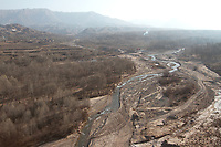 River, forests and mountains on the Qinghai-Tibetan Plateau. China