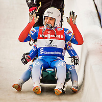 4 December 2015: Andrey Bogdanov and Andrey Medvedev, sliding for Russia, cross the finish line after their second run, finishing 10th for the day with a combined time of 1:28.747 in the Doubles Competition of the Viessmann Luge World Cup at the Olympic Sports Track in Lake Placid, New York, USA. Mandatory Credit: Ed Wolfstein Photo *** RAW (NEF) Image File Available ***