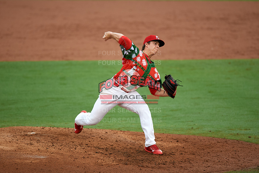 """Palm Beach Cardinals relief pitcher Ryan Helsley (26) delivers a pitch during a game against the Charlotte Stone Crabs on July 22, 2017 at Roger Dean Stadium in Palm Beach, Florida.  The Cardinals wore special """"Ugly Sweater"""" jerseys for Christmas in July.  Charlotte defeated Palm Beach 5-2.  (Mike Janes/Four Seam Images)"""