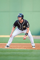 Matt Davidson (22) of the Charlotte Knights takes his lead off of first base against the Indianapolis Indians at BB&T Ballpark on May 23, 2014 in Charlotte, North Carolina.  The Indians defeated the Knights 15-6.  (Brian Westerholt/Four Seam Images)