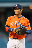 Houston Astros first baseman Carlos Pena (12) smiles during the MLB baseball game against the Detroit Tigers on May 3, 2013 at Minute Maid Park in Houston, Texas. Detroit defeated Houston 4-3. (Andrew Woolley/Four Seam Images).