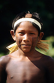 Bacaja village, Amazon, Brazil. A boy with a headband watches the hornets' nest initiation ceremony; Xicrin tribe.
