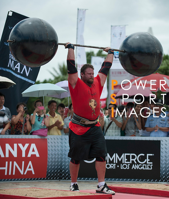 HAINAN ISLAND, CHINA - AUGUST 24:  Mike Burke of USA competes at the Circus Medley event during the World's Strongest Man competition at Yalong Bay Cultural Square on August 24, 2013 in Hainan Island, China.  Photo by Victor Fraile