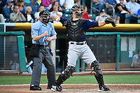 Kyle Skipworth (9) of the New Orleans Zephyrs behind the plate with home plate umpire Ryan Blakney during the game against the Salt Lake Bees in Pacific Coast League action at Smith's Ballpark on August 27, 2014 in Salt Lake City, Utah.  (Stephen Smith/Four Seam Images)