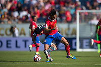 Orlando, Florida - Saturday, June 04, 2016: Costa Rican midfielder Bryan Ruiz (10) and Paraguayan forward Robert Piris Da Motta (23) get their legs tangled as they battle for possession during a Group A Copa America Centenario match between Costa Rica and Paraguay at Camping World Stadium.