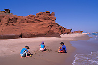 Ile du Havre-aux-Maisons, Iles de la Madeleine, Quebec, Canada - Children playing in Sand on Beach at Dune du Sud along Gulf of St. Lawrence - (South Dune, House Harbour Island, Magdalen Islands)