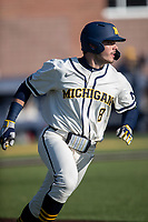Michigan Wolverines first baseman Jimmy Obertop (8) runs to first base during the NCAA baseball game against the Illinois Fighting Illini at Fisher Stadium on March 19, 2021 in Ann Arbor, Michigan. Illinois won the game 7-4. (Andrew Woolley/Four Seam Images)