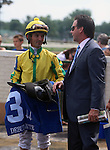 June 21, 2014:  Robby Albarado and trainer Bret Calhoun in the winner's circle after Promise Me Silver wins the Debutante Stakes at Churchill Downs. Owner Robert Luttrell.  ©Mary M. Meek/ESW/CSM