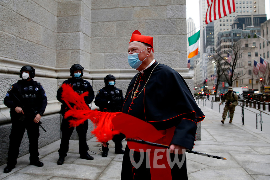 NEW YORK, NEW YORK - MARCH 17: The Cardinal Timothy Dolan enters to church before a mass during St. Patrick's Day on March 17, 2021 in New York. St. Patrick's Day Parade organizers say they postpone the celebration, but a small group marched to preserve the tradition. (Photo by John Smith/VIEWpress)