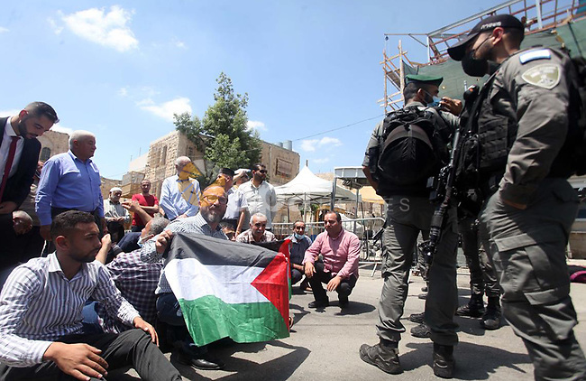 Israeli forces stand guard during an anti-Israel demonstration by Palestinian protesters, near Ibrahimi Mosque, also known as the Tomb of the Patriarchs, in the West Bank city of Hebron on August 10, 2021. Photo by WAFA
