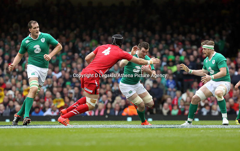 Pictured: Peter O'Mahony of Ireland (3rd L) tries to avoid a tackle by Luke Charteris of Wales (4) Saturday 14 March 2015<br /> Re: RBS Six Nations, Wales v Ireland at the Millennium Stadium, Cardiff, south Wales, UK.