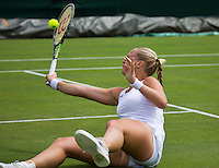 London, England, 30 june, 2016, Tennis, Wimbledon, Kiki Bertens (NED) returns the ball after she has fallen on the grass in her match against Mona Barthel (GER)<br /> Photo: Henk Koster/tennisimages.com