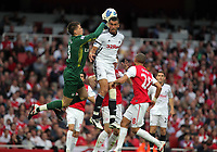 Pictured: Steven Caulker of Swansea (C) battles for a header against Wojciech Szczesny, goalkeeper of Arsenal who manages to save the ball (L). Saturday 10 September 2011<br />