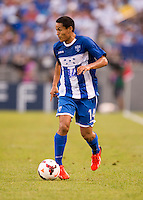Andy Najar (14) of Honduras brings the ball upfield during the quarterfinals of the CONCACAF Gold Cup at M&T Bank Stadium in Baltimore, MD.  Honduras defeated Costa Rica, 1-0.