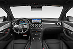 Stock photo of straight dashboard view of 2021 Mercedes Benz GLC-Coupe AMG-GLC-63-S 5 Door SUV Dashboard