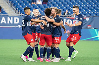 FOXBOROUGH, MA - JUNE 26: New England Revolution II congratulate Ryan Spaulding on his goal during a game between North Texas SC and New England Revolution II at Gillette Stadium on June 26, 2021 in Foxborough, Massachusetts.